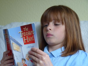 Girl absorbed in reading a story