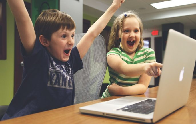 Children looking at laptop