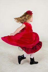 Girl in red velvet dress