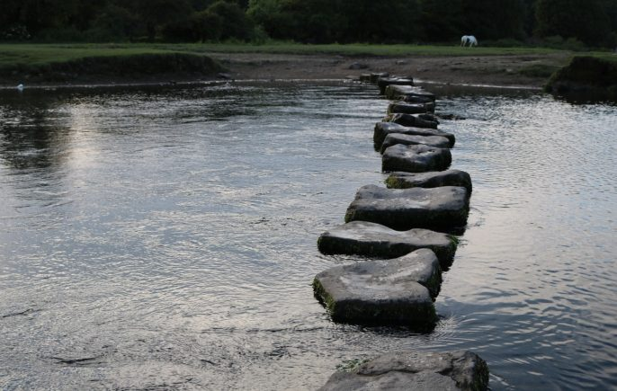 stepping stones across a river
